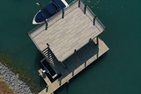 The pier on the lake with Dolomiti lake%20norman%20(4) - Ceramica del Conca